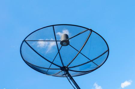 Satellite dish on the blue sky field.