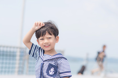 Portrait of young sailor boy with the sea. 版權商用圖片