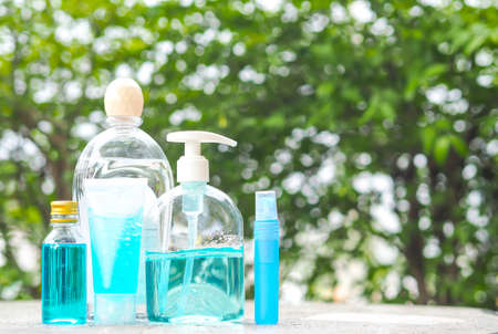 Alcohol Gel and Alcohol Spray in plastic bottle on table with blur nature background. Alcohol gel and Alcohol Spray is very important in daily life.