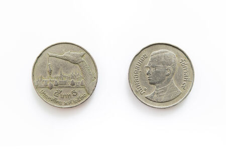 Old Coin for 5 Baht in Thailand Isolated on white background photo
