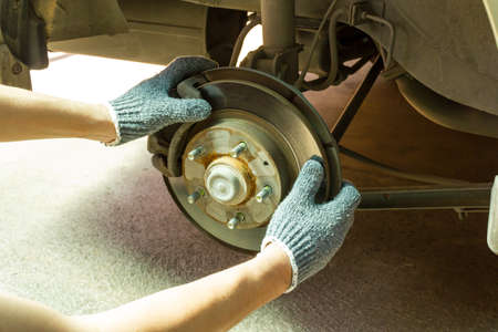 Checking suspension and brake system, Car Service. 免版税图像
