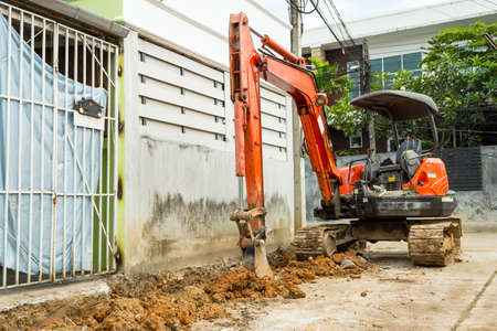 Hydraulic hammer is building a Drainage, Digging road surface.