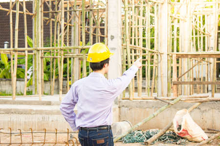 Business man, Home construction site engineer. (sun flare effect)