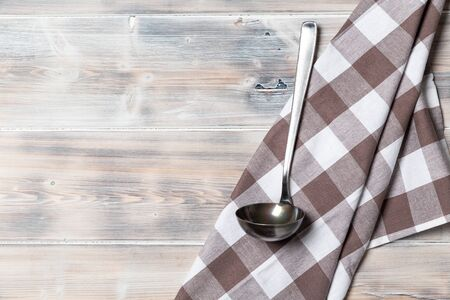 A wooden vintage Table or background with a ladle