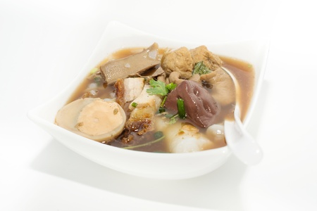 entrails: Boiled Chinese pasta squares ; paste of rice flour  Sweet Chinese Pasta with pork entrails stewed in the gravy