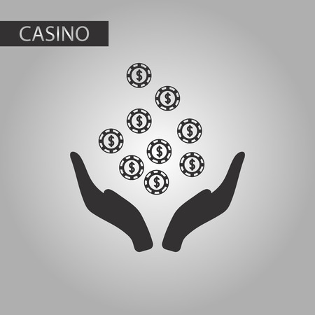 black and white style poker coins in hand