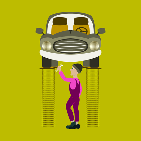 Mechanic standing under car and repairing a car lifted on auto hoist