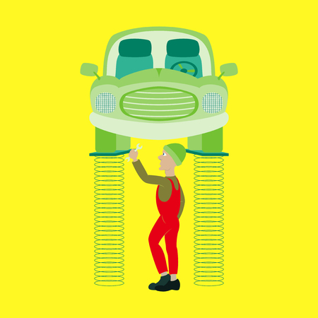 auto hoist: Mechanic standing under car and repairing a car lifted on auto hoist