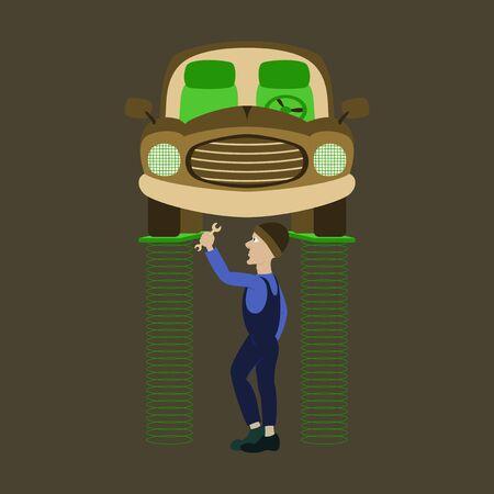 자동차 아래에 서서 자동 호이스트에서 들어 올린 자동차 수리 기술자