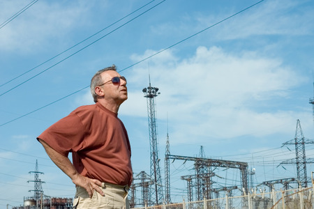 The man on a background of electric substation photo
