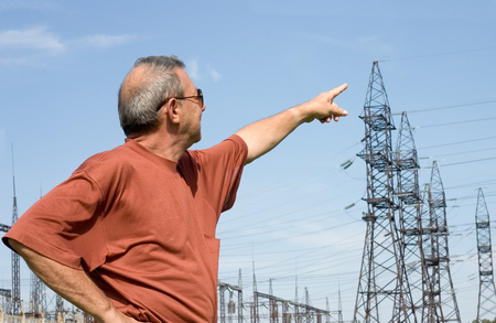 The man on a background of electric substation