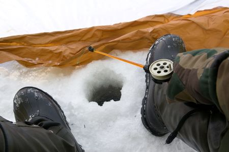 pending: The fisher on winter fishing pending a biting Stock Photo