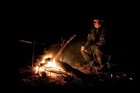 The hunter has a rest at a bonfire