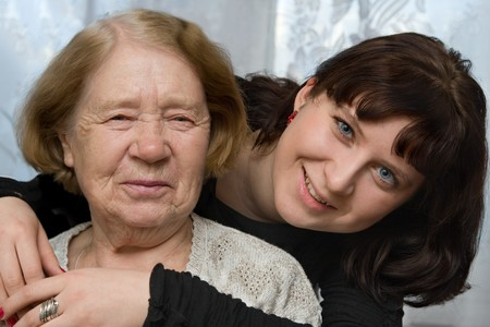 grand daughter: The grand daughter embraces the grandmother Stock Photo