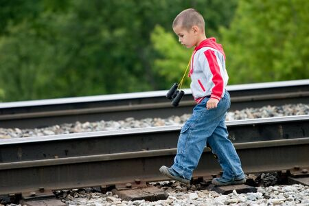 cross ties: The boy going by rail
