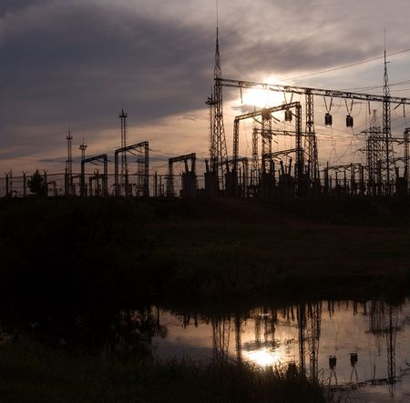 Electric substation on a background of the coming sun Stock Photo