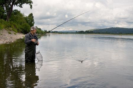 Fishing on the mountain river with fast current Stock Photo - 5894794