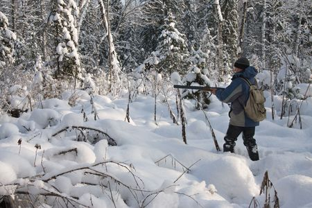 The hunter on hunting in a winter wood