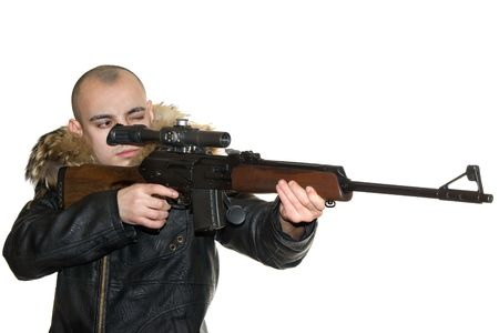 Young the man aims from a carbine with an optical sight photo