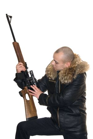 Young the man considers a carbine with an optical sight photo