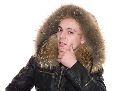 Young the man in a black jacket with a fur collar photo