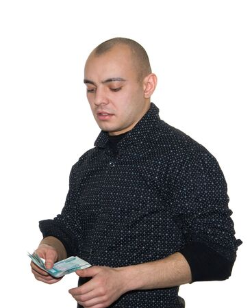 The young man with money for a white background photo