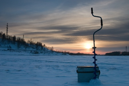 frozen lake: Sunset in the winter on winter fishing