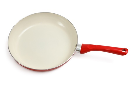 Frying pan with ceramic isolated on white background photo