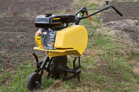 mechanization:  New cultivator motor in the garden  Stock Photo