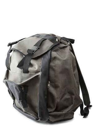 packsack: A small backpack is isolated on a white background Stock Photo