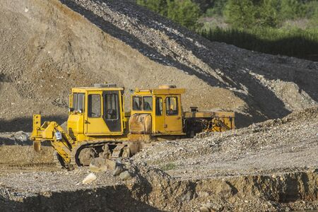 bulldozers: Two bulldozers working on the extraction of gravel