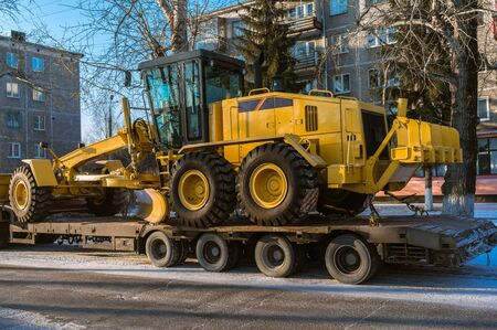 grader: transportation of the new Road Grader on a trailer