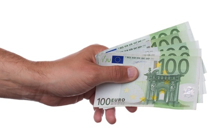 Hand holding hundred euro notes