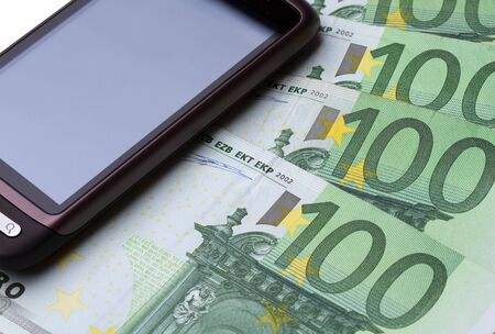 Phones places on 100 euro notes Stock Photo