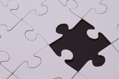 Puzzle with missing black brick Stock Photo