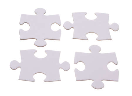 Four puzzle bricks fitting together Stock Photo