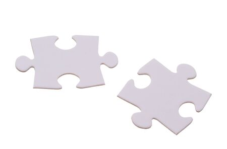 Two puzzle bricks which could fit together photo
