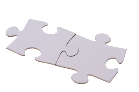 Two puzzle bricks fitting together