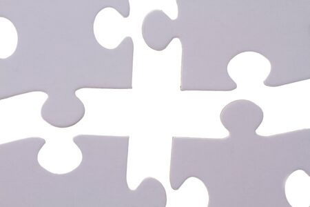 four jigsaw bricks fitting together. Stock Photo