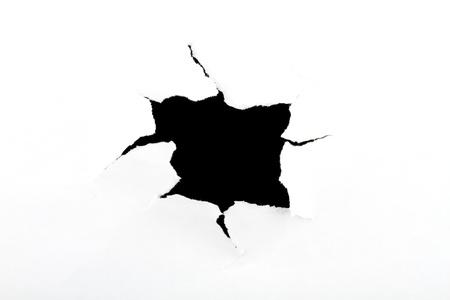 zwart gat: Zwart gat in een wit papier, naar buiten Stockfoto