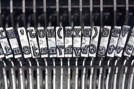 Line of typebars on an old typewriter photo