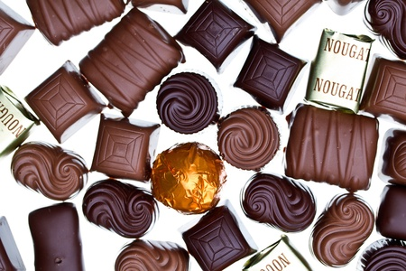 Top view of many chocolate pralines