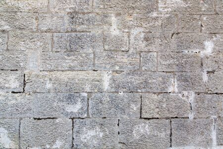 Very old wall with large stone bricks