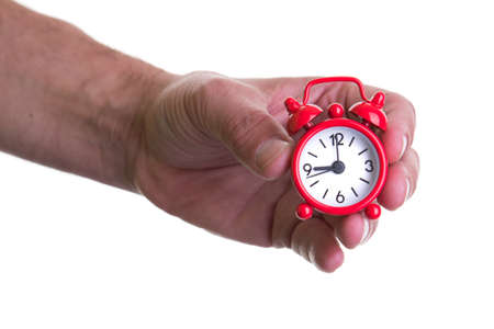 Hand holding small alarm clock Stock Photo - 17626771