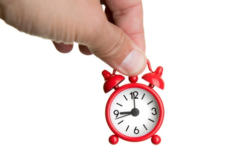Alam clock hanging from hand Stock Photo - 17626770