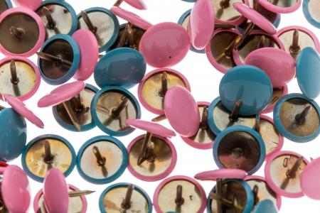 Closeup of a pile of thumbtacks
