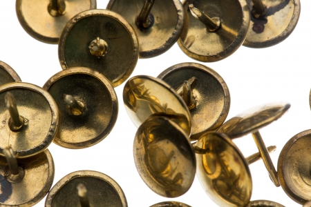 Closeup of brass thumbtacks