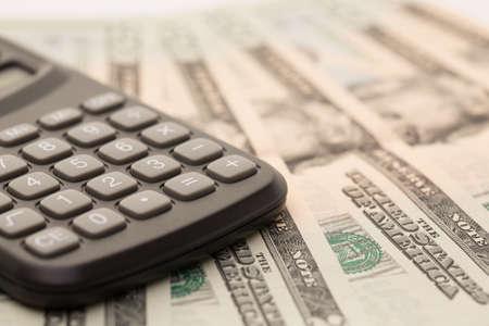 Calculator and banknotes closeup