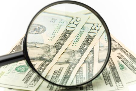 Banknotes seen through magnifying glass