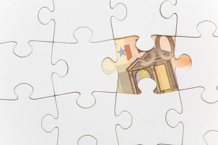 Missing jigsaw piece showing a banknote